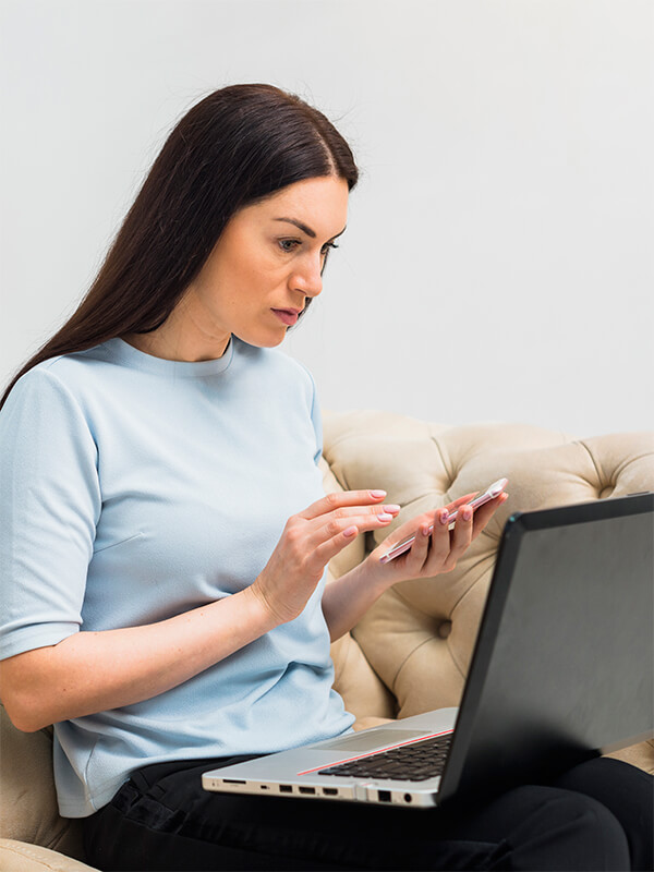 woman-with-laptop-and-smartphone